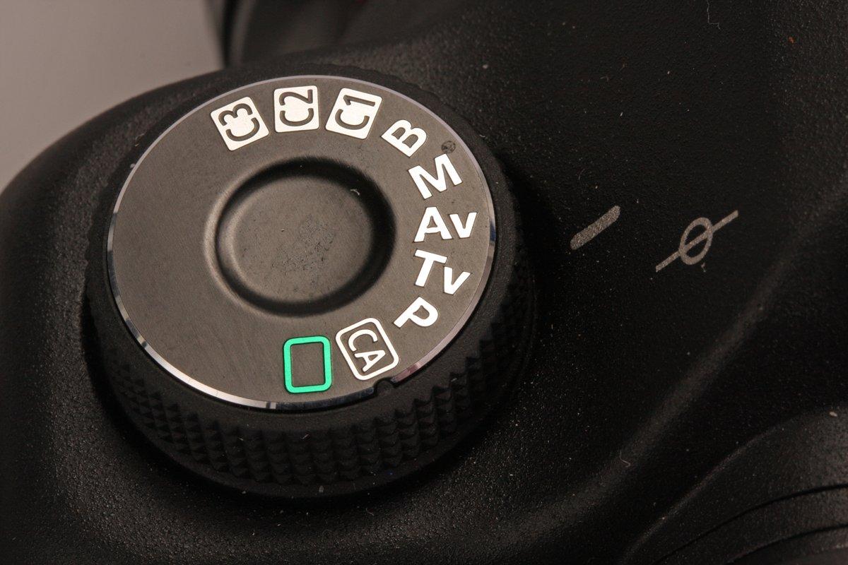 De draaiknop op een spiegelreflex waarmee je verschillende programma's in kunt stellen.